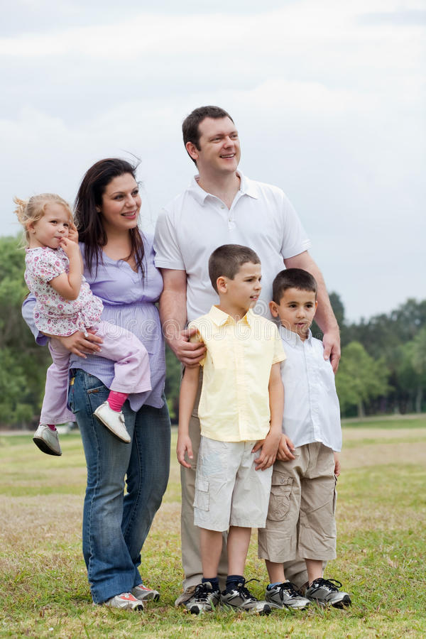 Download Happy Family With Three Kids Looking Away Stock Image - Image: 14685951