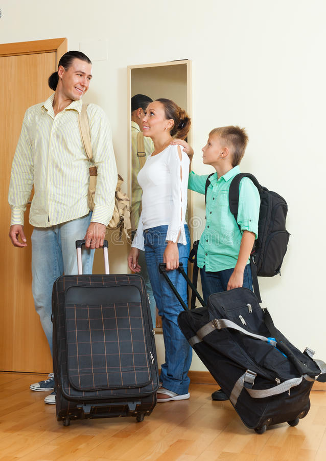 Happy family of three leaving the home royalty free stock images