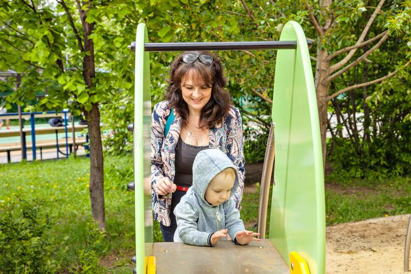 Happy family moms with two year old son for a walk. stock photos