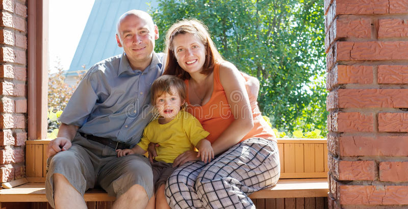 Happy family of three  in summer