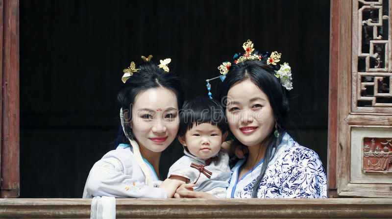 Happy family time, Chinese woman in Hanfu dress with baby girl royalty free stock photo