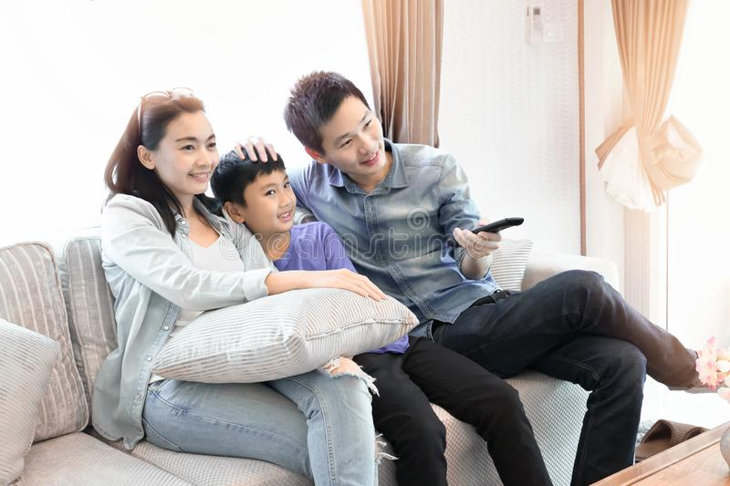 Happy family time. Mother, Father and son relaxing at home stock image
