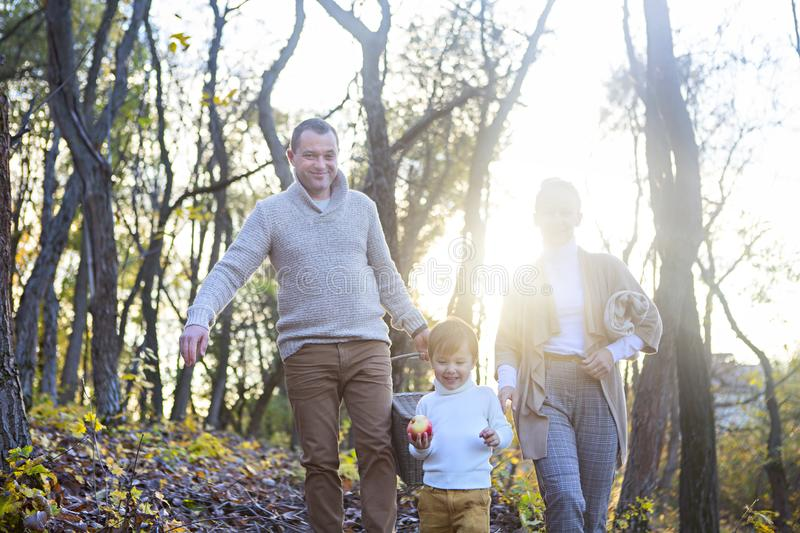 Happy family together on autumn picnic in the evening stock image