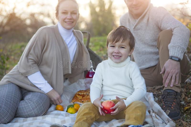 Happy family together on autumn picnic royalty free stock photos