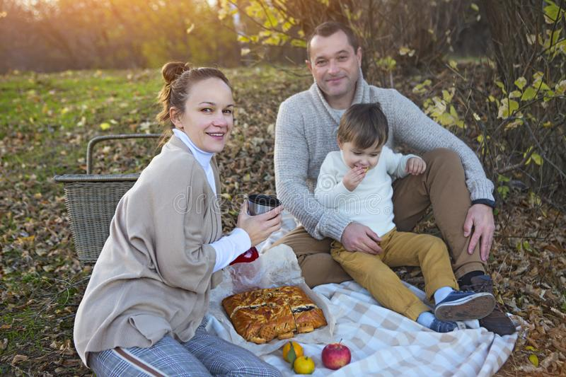 Happy family together on autumn picnic stock image