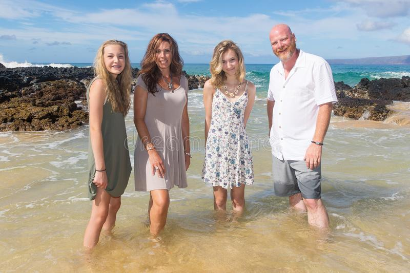 Happy Family together at the beach. Family of four on vacation at tropical island stock images