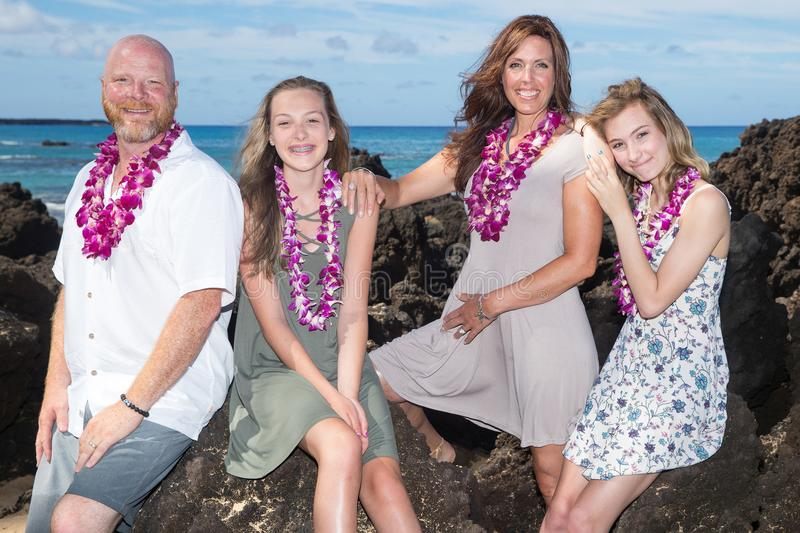 Happy Family together at the beach. Family of four on vacation at tropical island royalty free stock photo