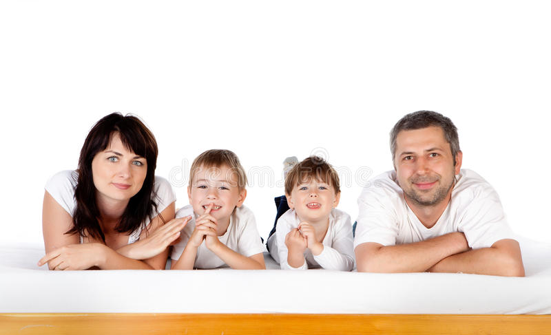 Happy family together on bed stock image