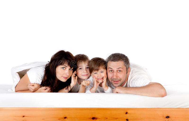 Happy family together on bed stock images