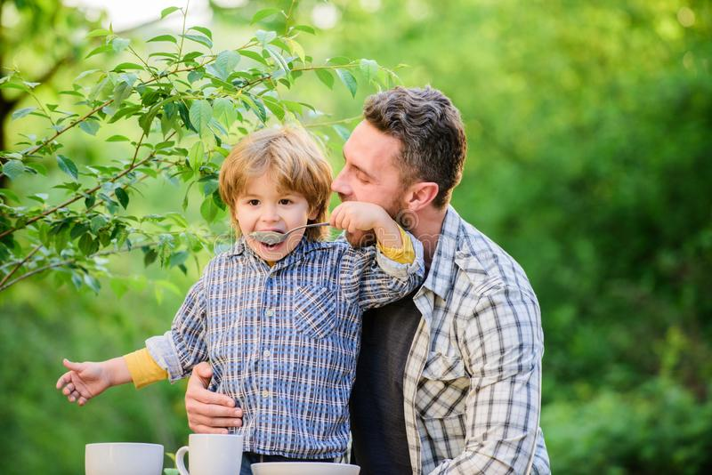 Happy family together. Child development. son and father eating milk porridge. happy fathers day. Little boy with dad stock image