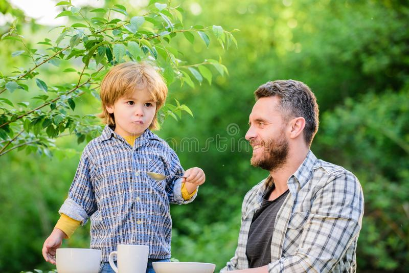Happy family together. childhood happiness. Food habits. happy fathers day. Little boy with dad. Preparation of food royalty free stock images