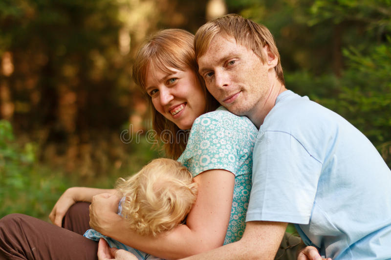 Happy family together in nature royalty free stock image