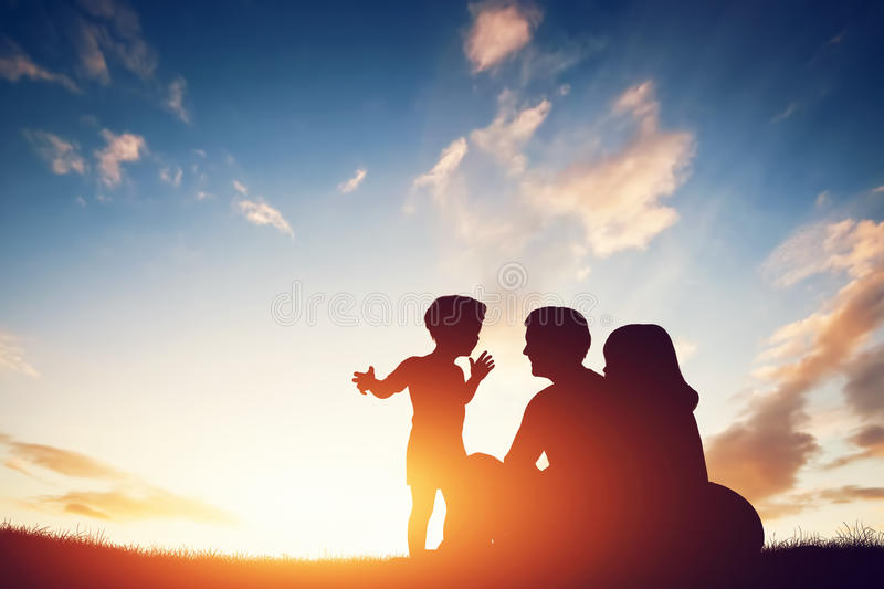 Happy family together, parents with their little child at sunset. royalty free illustration