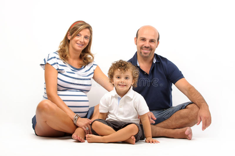 Happy family together with pregnant woman royalty free stock photography