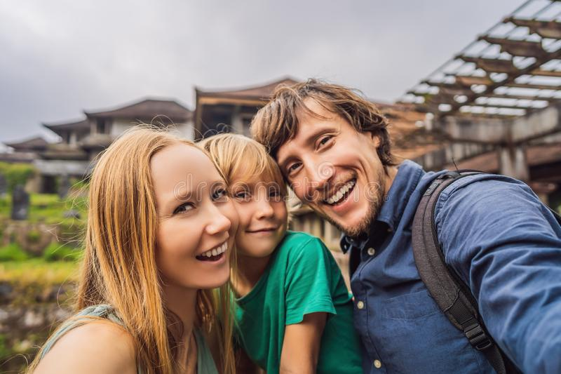 Happy family of tourists in abandoned and mysterious hotel in Bedugul. Indonesia, Bali Island.  stock photos