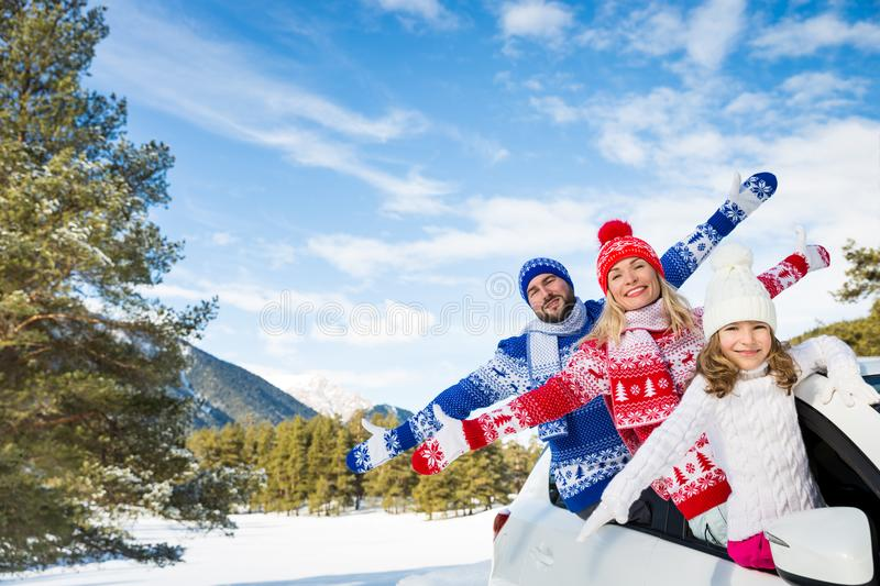 Happy family travel by car in winter stock image