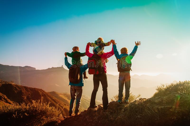 Happy family travel in mountains at sunset royalty free stock images