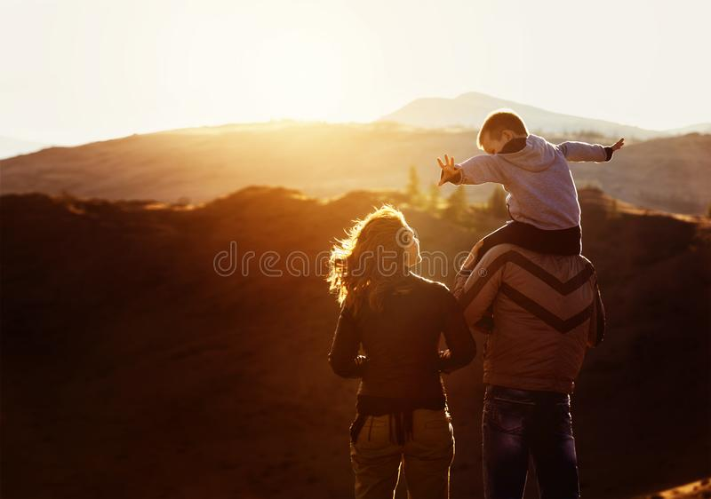 Happy family travel sunset concept royalty free stock photography