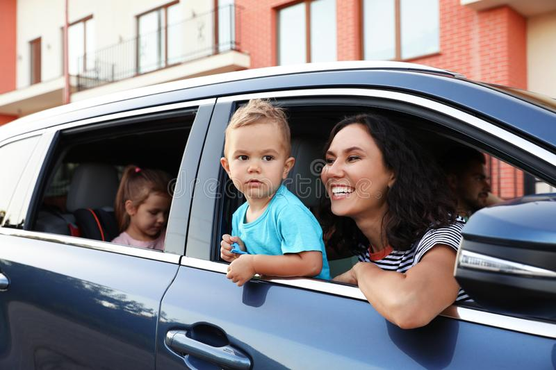 Happy family traveling by car royalty free stock photography