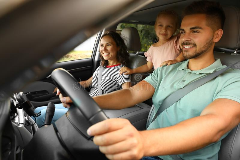 Happy family traveling by car royalty free stock photos