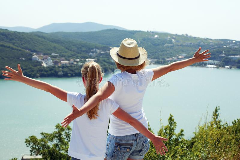 Happy family traveling: mother and child daughter royalty free stock images