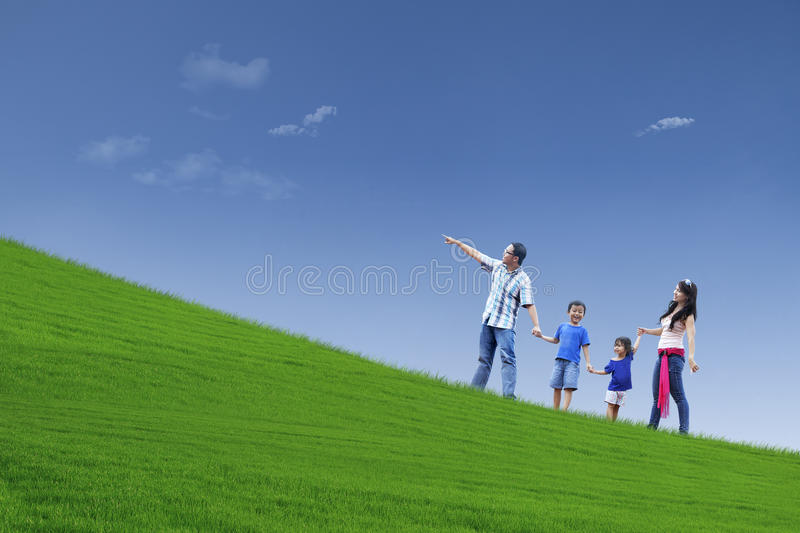Happy family trip on hill. Happy family walking on the hill to see beautiful landscape