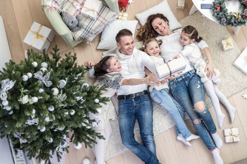 Happy family celebrating Christmas royalty free stock photos