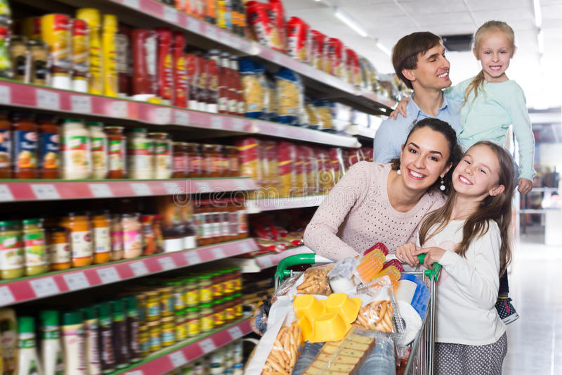 Happy family with two daughters shopping royalty free stock photos