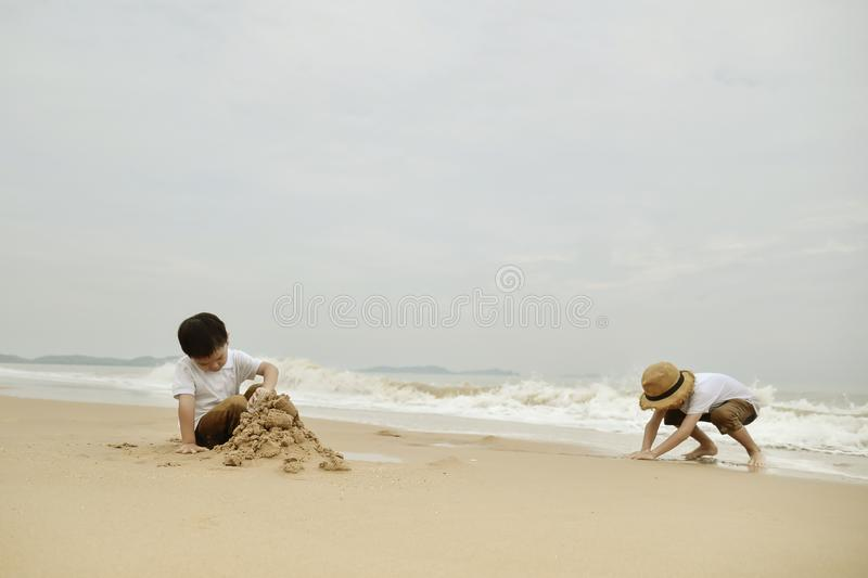 happy family with two kids on the beach stock photo