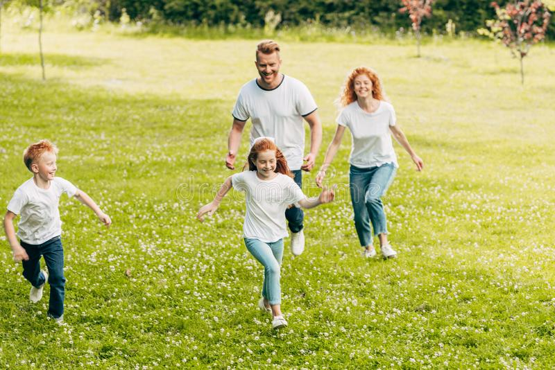 happy family with two kids having fun and running together royalty free stock photos