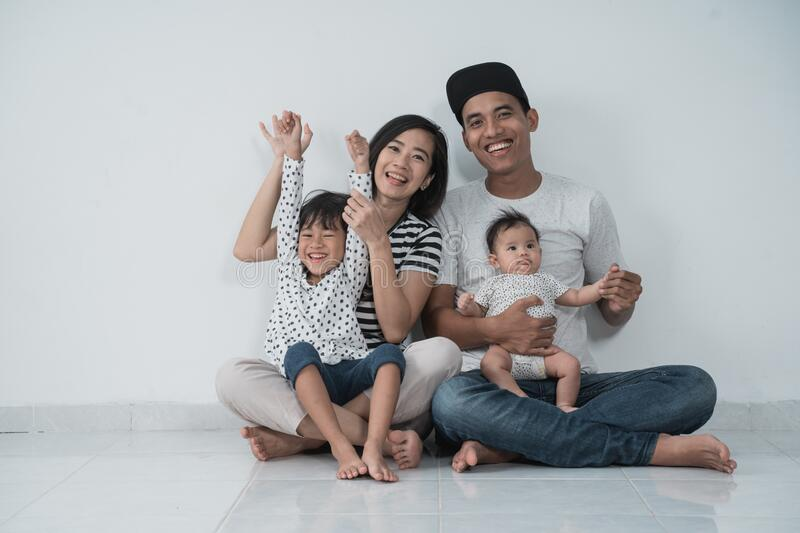 Happy family with two kids wearing casual clothes with isolated background royalty free stock photos