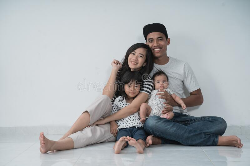 Happy family with two kids wearing casual clothes with isolated background stock photos