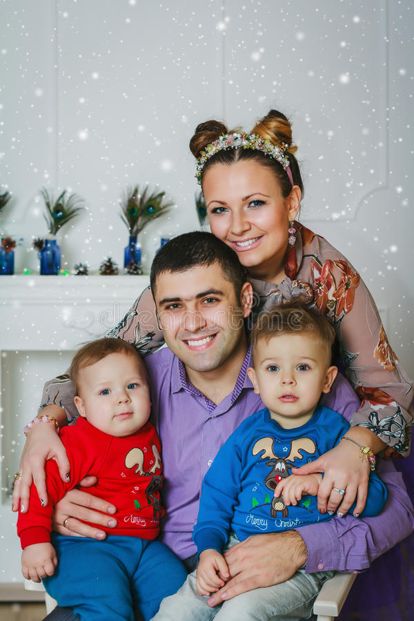 The happy family with two small boys royalty free stock image