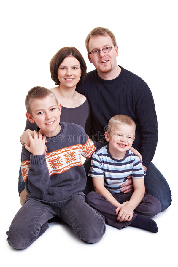 Happy family with two sons. Portrait of a happy family with father and mother and two children stock images