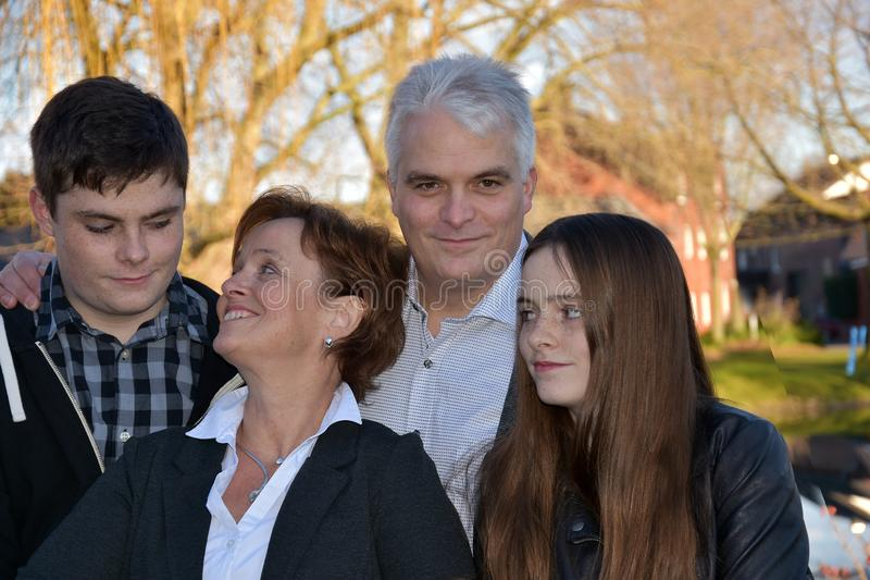 Happy family with two teenagers stock photography