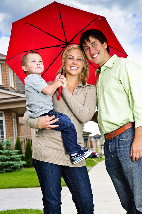Happy family with umbrella royalty free stock photography