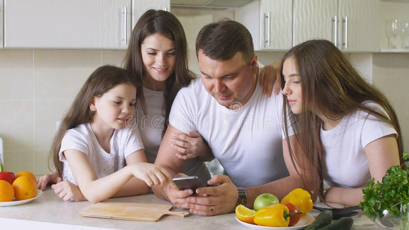 Happy Family Uses a Smartphone For Shopping on the Internet royalty free stock photos