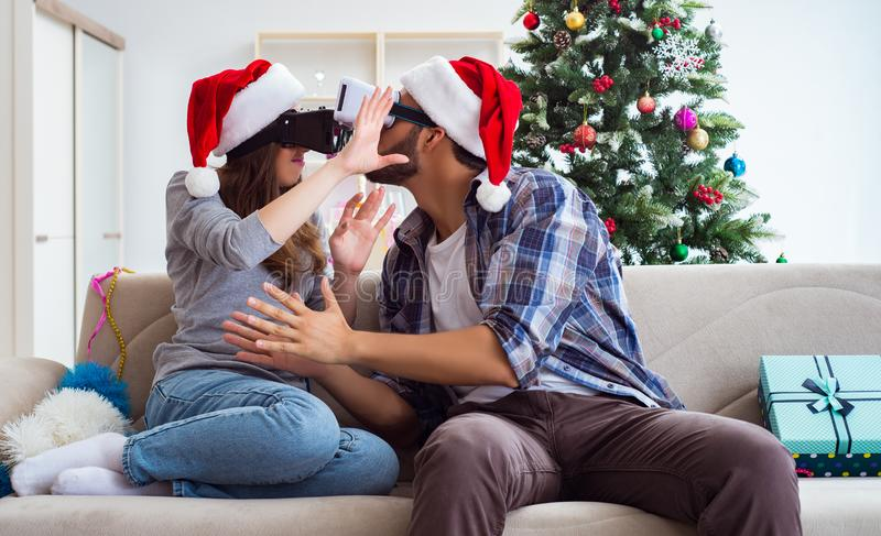 Happy family using virtual reality VR glasses during christmas stock photo