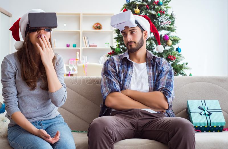 Happy family using virtual reality VR glasses during christmas royalty free stock image