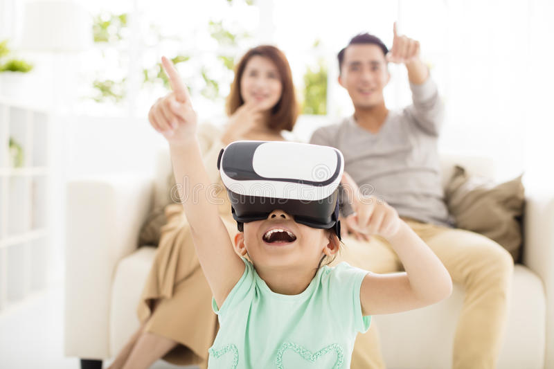 Happy family with virtual reality headset in living room royalty free stock photography