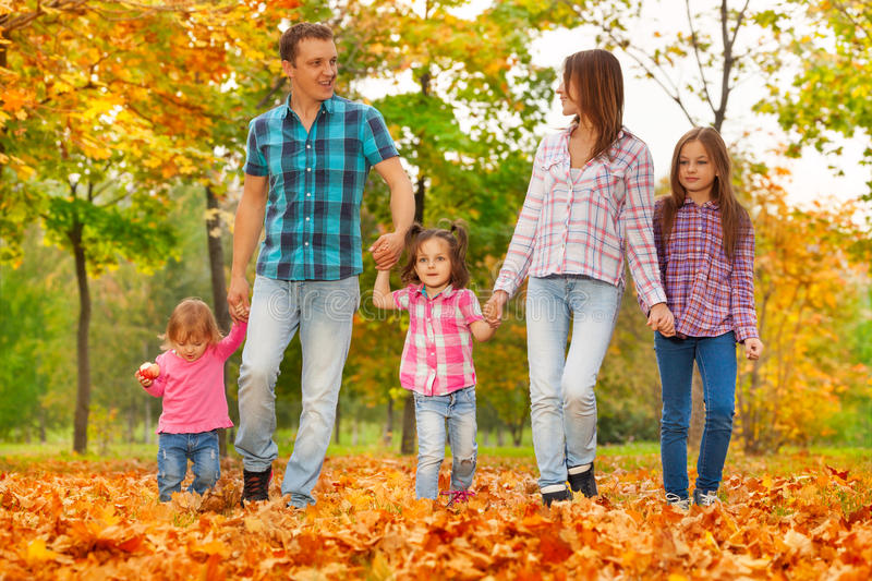 Happy family walk in Autumn October park royalty free stock images