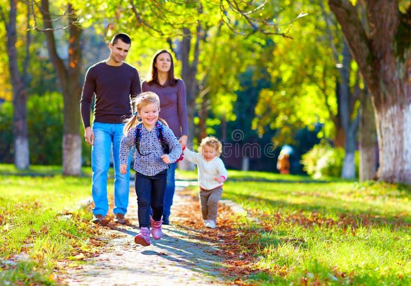 Happy family on walk in park stock image