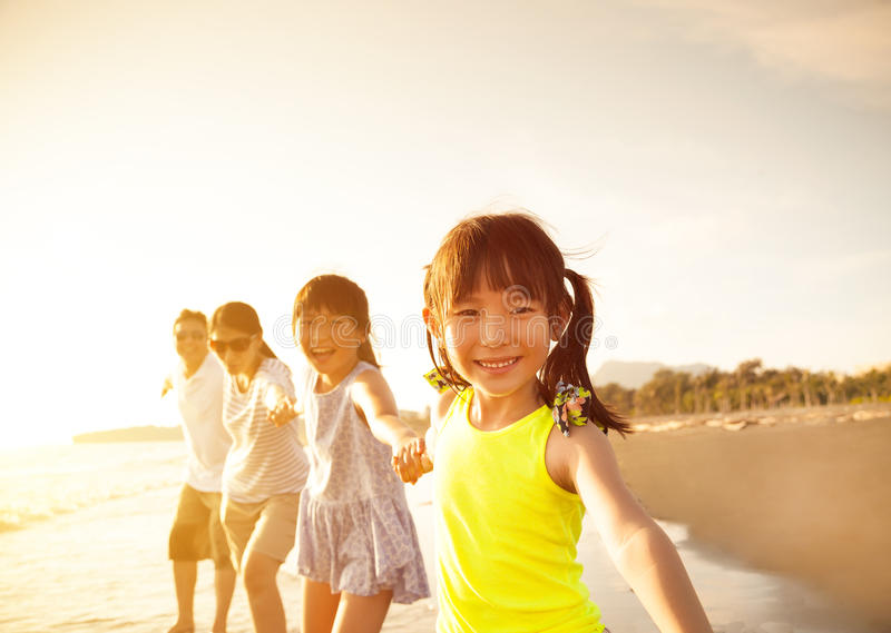 Happy family walking on the beach stock image