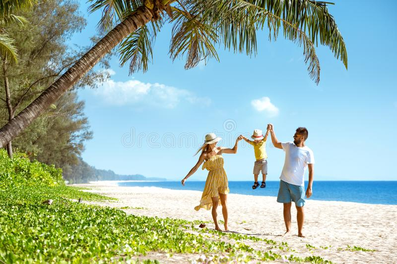 Happy family walking beach tourism royalty free stock images
