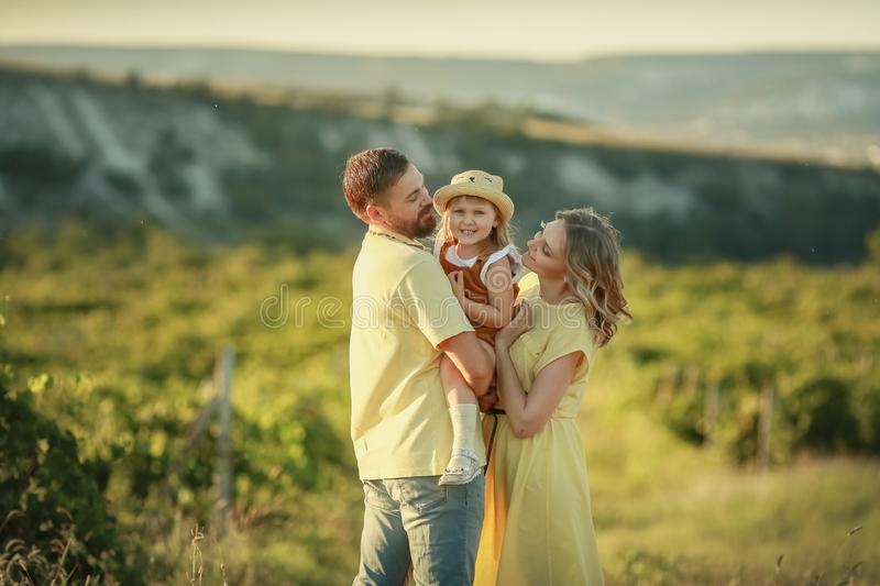 A Happy family walking history. mother and baby hugging in a meadow yellow flowers on nature in summer stock images