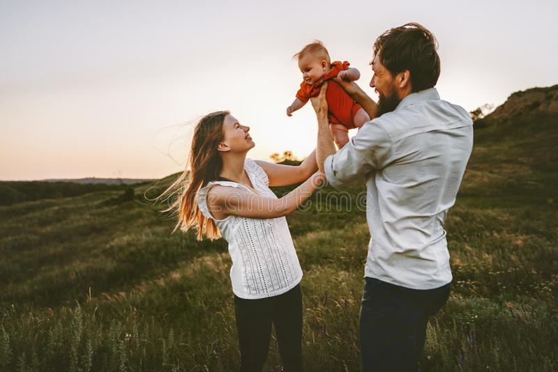 Happy family walking with infant baby outdoor royalty free stock image