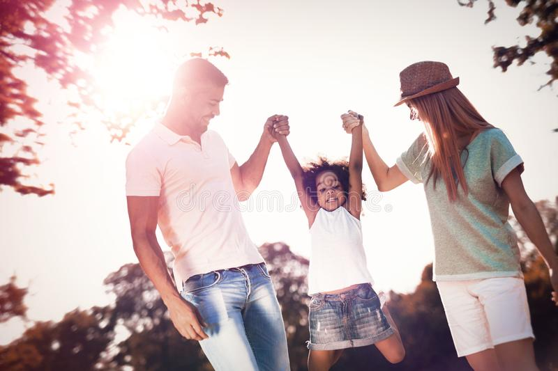 Happy family walking in nature with child stock images