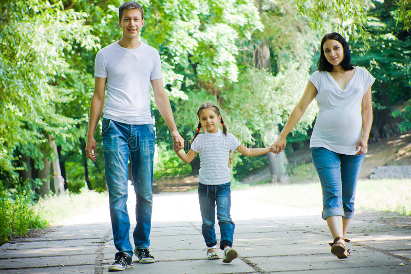 Happy family walking stock photography