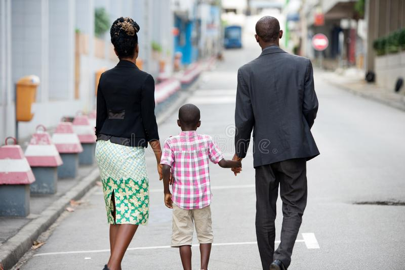 Happy family walking together stock images