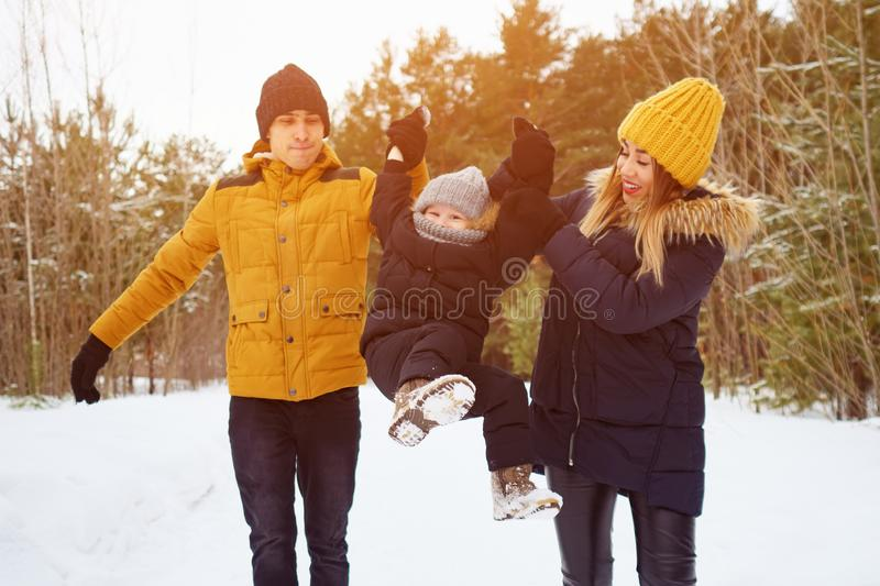 Happy family walking in winter day in forest. Family, weekend and holiday concept stock images